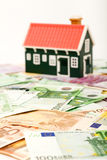 House on money field or foundation Stock Images