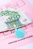 House and money on home plan Royalty Free Stock Photos