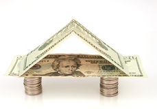 House of Money. House made with American bills and coins Stock Image