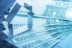 House and money  over laptop keyboard Royalty Free Stock Photo