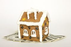 House and money over white Stock Photos
