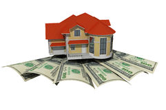 House with money over white background. Mortgaging concept Stock Photos
