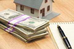 House and Money with Pad and Pen. House and Money with Pad of Paper and Pen Royalty Free Stock Photos