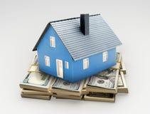 House on money. Real estate symbol on money pile Stock Photos