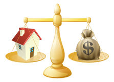 House money sack scales. Concept with a house on one side and sack of money on the other Royalty Free Stock Photo