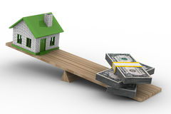 House and money on scales Stock Photos