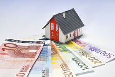 House and money. House and several Euro bills Stock Photo