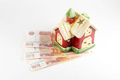 House and money on a white background Royalty Free Stock Photo