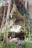 House of monk in a rock in the ancient forest Stock Photo