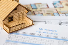 House mortgage application with model house Stock Photos