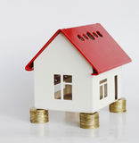 House. Mortgage concept by money house from coins Stock Images