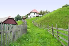 House at the mountain. Path leading to a house at the mountain Royalty Free Stock Images