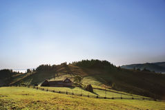 House on mountain. A house with fence in the Carpathian mountains of Bucovina, Romania Stock Images