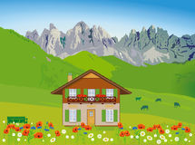 House on mountain backdrop Stock Photo