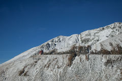 House on the mountain. Building perched on a road cutting through the top of the mountains in Romania royalty free stock photo