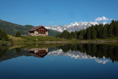 House and mountain lake landscape. Mountain lake. Italian Alps, summer 2010 Stock Photos