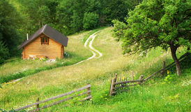 House in mountain meadow Royalty Free Stock Photos