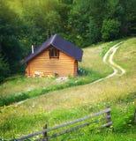 House in mountain meadow Stock Photos
