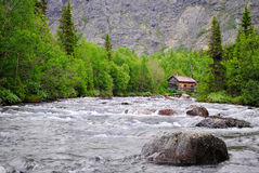 The house on the mountain river Stock Photography