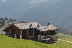 House in mountain with solar panels Stock Photography