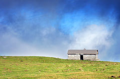House in mountain in sunny day Stock Photo
