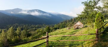 House in mountain village, forest nature landscape stock images