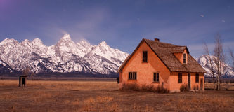 House by mountains moonlit night horizontal Stock Photos