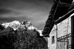House in mountains. Side of a rugged stone house in the mountains.  Black and white Royalty Free Stock Photography
