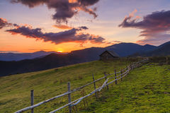 House in the mountains at dawn Stock Photos