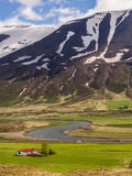 House and mountains in Iceland Stock Photos