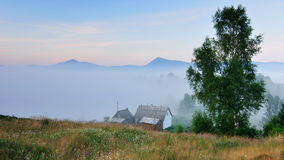 House in the mountains. The picture was taken early in the moning in the Carpathians Royalty Free Stock Image