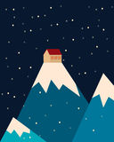House in the mountains. Snow in the night sky Royalty Free Stock Image