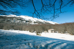 house in the mountains with snow Stock Photography