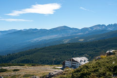 House in the mountains. Stay at home in the mountains and on the mountain top Stock Photos