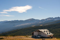 House in the mountains. Stay at home in the mountains and on the mountain top Royalty Free Stock Image