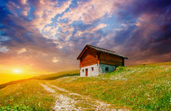 House in the mountains at sunset Stock Photography