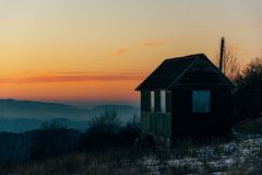 House in mountains with sunset stock photo