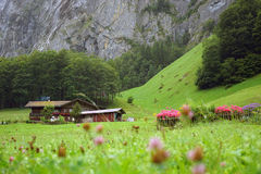 House in the mountains. House in the Swiss Alps in the valley of the waterfalls stock photos