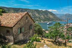 House in the mountains. And view on Kotor bay  from Lovcen Mountain. Montenegro Royalty Free Stock Photo