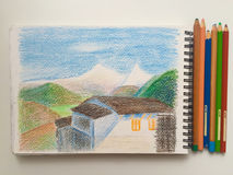 House and mountains on a white background with pencils, Himalaya sketchbook Stock Photography