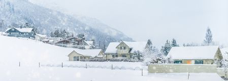 House in the mountains in winter Stock Photo