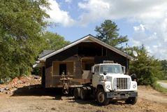 House Movers. A house being relocated by house movers Royalty Free Stock Image