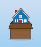 House Moving Box. House inside moving cardboard box Royalty Free Stock Photography