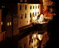 House with the moving of a wheel of a watermill. Beautiful Night view of the house with the moving of a wheel of a watermill Stock Photography