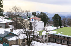 A House at Murree in winter, Pakistan. This photo is taken in Murree, Pakistan. Murree is a colonial era town located on the Pir Panjal Range within the Murree stock photo