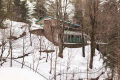A House at Murree in winter, Pakistan. This photo is taken in Murree, Pakistan. Murree is a colonial era town located on the Pir Panjal Range within the Murree stock image