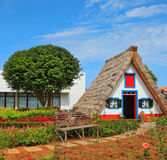 The house-museum of the first settlers on the Madeira. Old house-museum of the first settlers on the island of Madeira. Charming white cottage with a thatched Stock Image