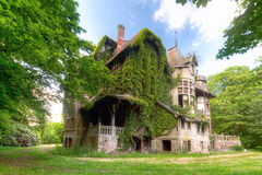 House of mystery. This abandoned house is full of mystery. Overgrown and decay at its best stock image