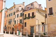 House on a narrow street in the Italian city of Venice Stock Photos