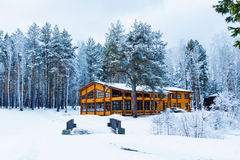 House in a nature area covered with freshly fallen snow. Royalty Free Stock Image